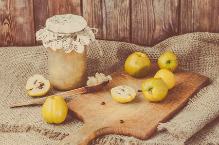 Quince jam in a wooden pantry. Stock Photo