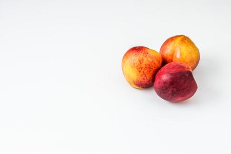 Ripe nectarine isolated on white background.
