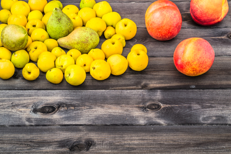 Various fruits on wooden background.