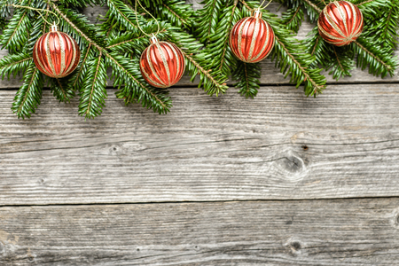 Christmas background with ornaments and fir tree branches on wooden board Stock Photo