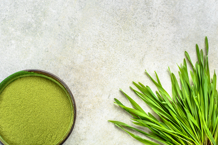 Barley grass detox superfood, powder and sprouts, vegan green diet for health and wellbeing Stock Photo