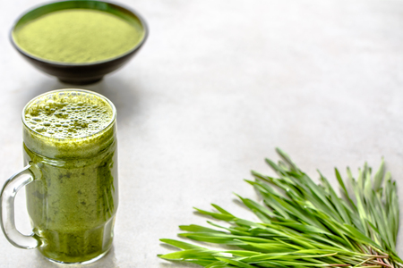 Detox drink with organic barley grass, healthy green juice in jar