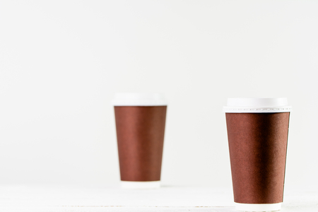 Paper cup to coffee takeaway. Brown cups with lid for safety drinking.