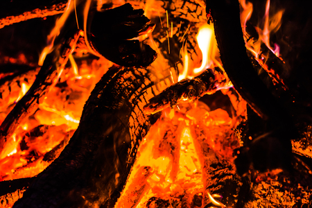 Fire in fireplace with burning wood or bonfire in the night camp 写真素材