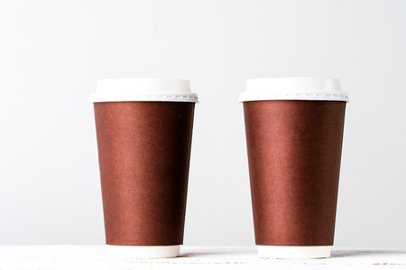 Takeout coffee cup on white. Brown paper cups isolated. Stok Fotoğraf