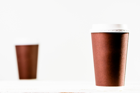 Coffee cup isolated. Brown cups with lid on white background.