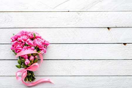 Pink bouquet on table, spring flowers on white background, gift for mothers day or wedding invitation, mockup