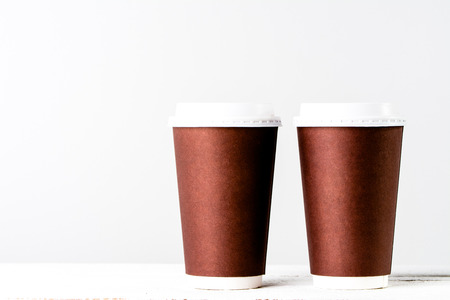 Disposable paper cup to coffee take away. Brown cups with lid for safety drinking. Stok Fotoğraf