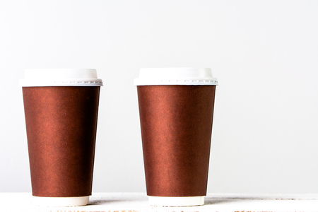 Takeaway coffee cup isolated. Disposable cups with paper in brown.