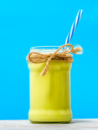Jar of smoothie with avocado or green milk shake, healthy diet concept