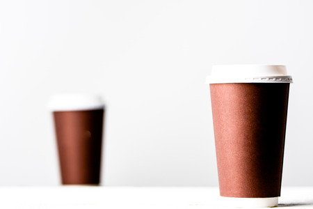 Takeout coffee cup on white. Brown paper cups isolated. Stock Photo