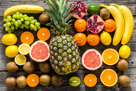 Farm table with fruits, flat lay. Fresh fruit background, healthy food and clean eating concept.