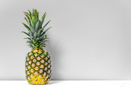 Tropical fruit, fresh pineapple on table Imagens