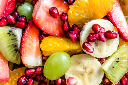 Fresh salad with fruit, various colorful fruits, natural background Stock Photo