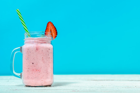 Healthy smoothie with fruits and milk, blended strawberry milkshake in jar, drink with vitamins and protein. 写真素材