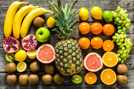 Tropical fruit mix on table. Fruits as healthy clean eating and dieting concept.