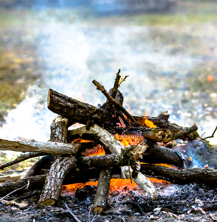 Campsite and campfire with smoke and heat