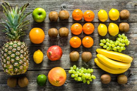 Tropical fruit on table, farm fresh organic fruits on market, flat lay, overhead