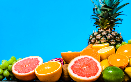 Tropical fruit assortment, various exotic fruits on table. Vegan food and healthy lifestyle concept.
