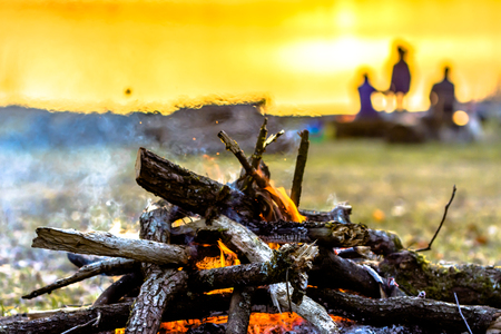 Group of friends on camp with campfire, camping in nature Banque d'images - 102554010