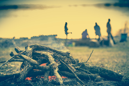 Group of people on camp with campfire, camping in nature