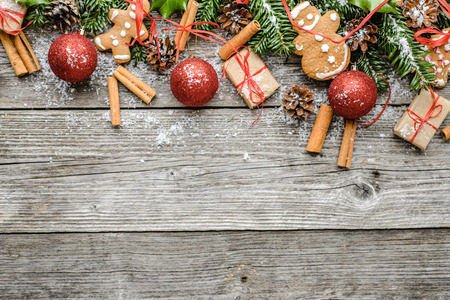 Wooden background with christmas decorations - gifts and ornaments, flat lay, top view Banco de Imagens - 102994901