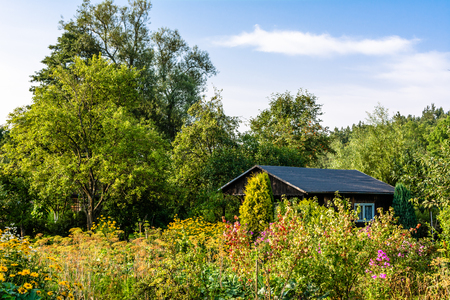 Summer house in the garden. Rural cottage in countryside. Stock Photo