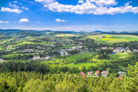 Countryside landscape in the valley, panoramic view of town with houses on foothills with green forest Reklamní fotografie - 104004821