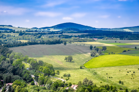 Farm field in green valley in mountains, landscape, Sudety in Poland
