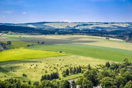 Farm field in green valley, landscape, Sudety in Poland