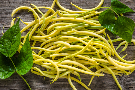 Yellow bean, fresh vegetables on local farmer market, freshly harvested beans on wooden table