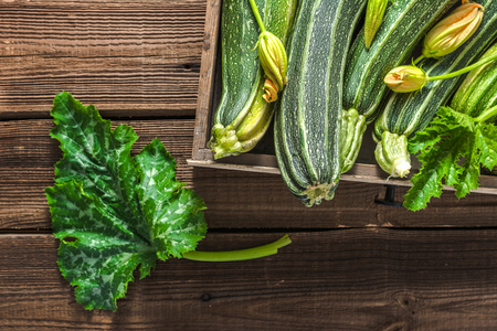 Fresh zucchini in a box, vegetables on local farmer market, freshly harvested courgette, summer squash