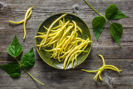 Yellow bean, farm fresh vegetables and organic produce - fresh beans on wooden background