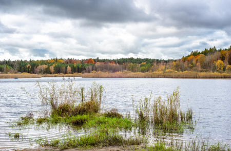 Lake in autumn, landscape with cloudy sky Stock Photo
