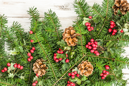 Background with christmas decoration, fir tree branch and ornaments on wooden table Stockfoto