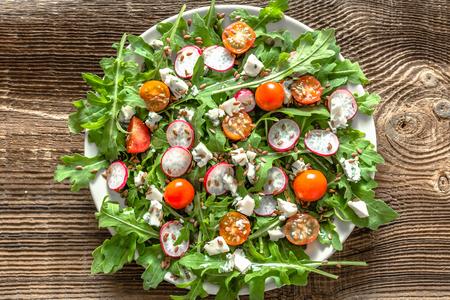 Healthy vegetable salad with fresh vegetables, vegetarian food on plate, overhead