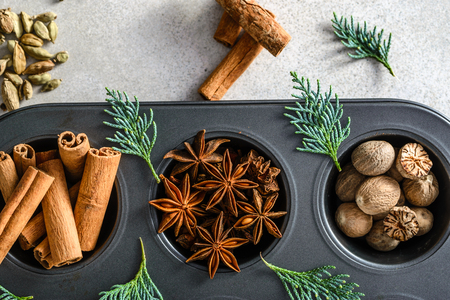 Christmas spices for baking. Cinnamon sticks, star anise, nutmeg.
