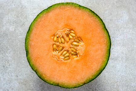 Half of melons, orange cantaloupe melon slice