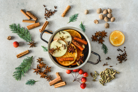 Christmas mulled wine with apple, orange and spices, hot drink cooking Stock Photo - 108542792