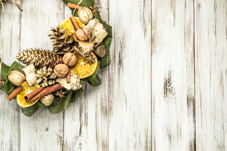 Christmas wooden background, wreath with decoration on wood