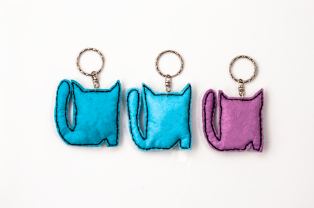 Cats key rings isolated on white background 版權商用圖片