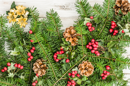 Christmas background with fir branch and decoration on wooden table Stockfoto