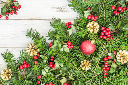 Background with christmas decoration, fir branch and ornaments on wooden table Stockfoto