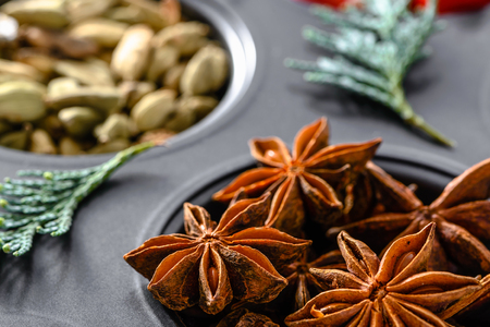 Star anise - christmas spices for baking, food background Stock Photo