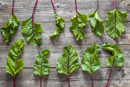 Green vegetables - fresh beet leaves, background, flat lay