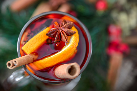 Christmas mulled wine, hot drink in a glass, top view
