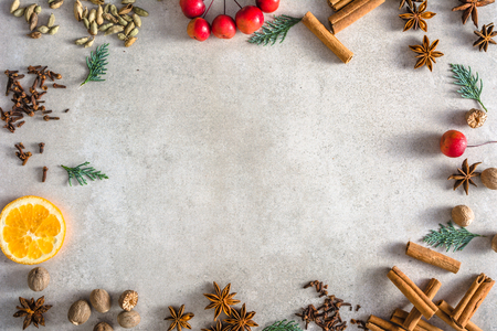 Christmas spices background, baking ingredients arranged in frame of food, copy space
