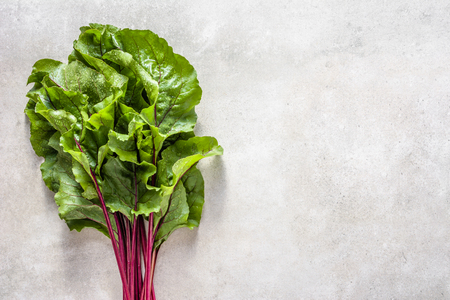 Bunch of sweet beet leaves. Green vegetables, top view Stock Photo - 111270371