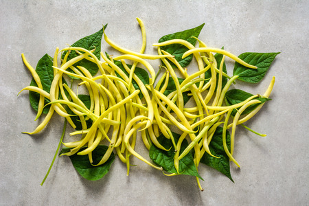 Fresh bean, yellow pods of beans on white background. Freshly harvested vegetables, organic food concept.