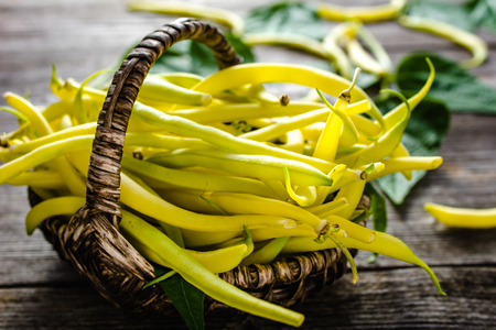 Fresh yellow bean, organic vegetables on farmer market, freshly harvested beans on wooden background